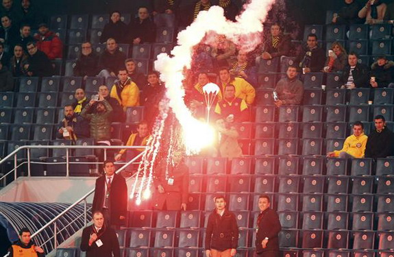 A flare on a parachute falls at Şükrü Saracoğlu Stadium