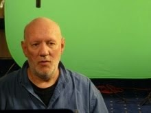 Brian Vike sitting in front of a green screen for the Discovery Channel.