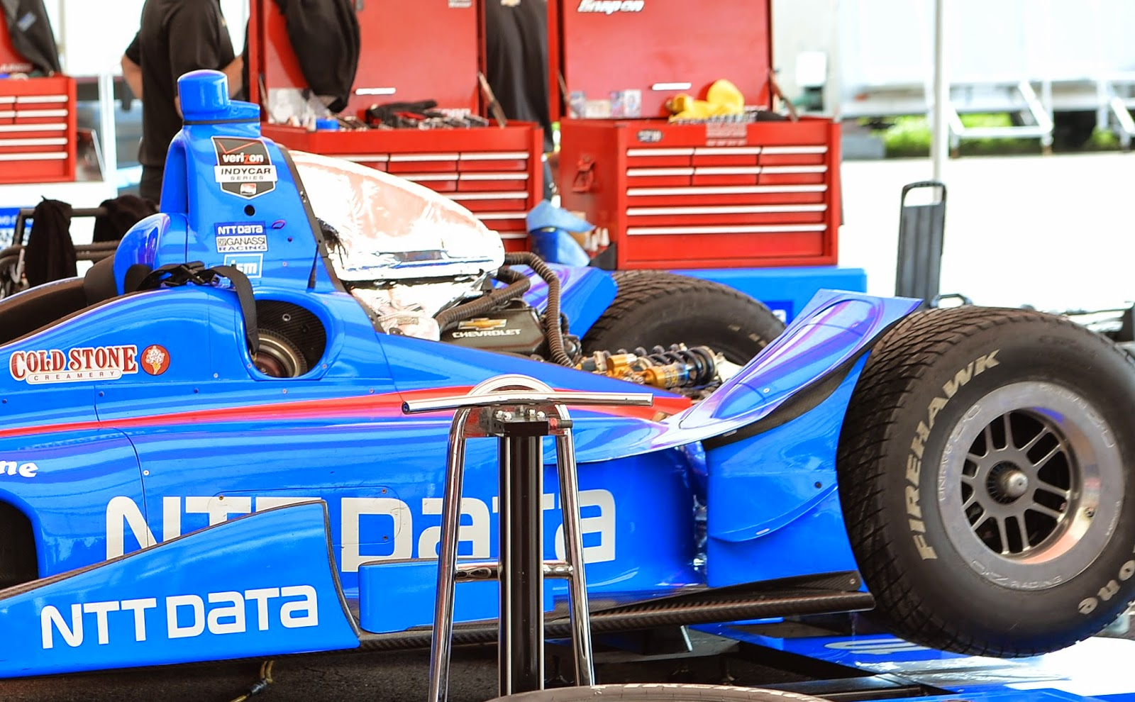 Tony Kanaan's Chevrolet in the paddock getting serviced.