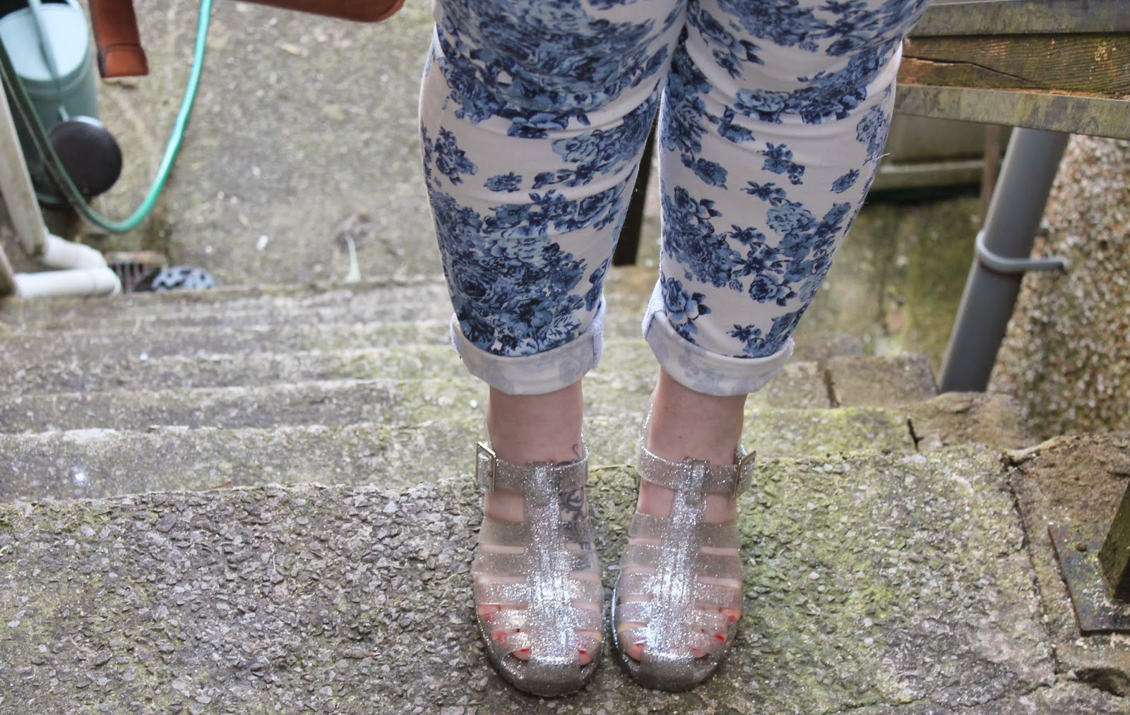 blue & white floral jeans and glitter jelly sandals
