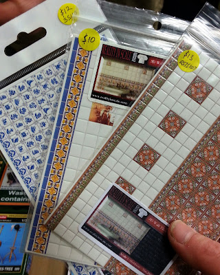 A 1/35 scale wall tile sets on display on a stand at a scale model exhibition.