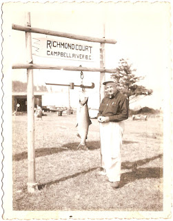 man displaying his catch from the Campbell River in British Columbia in Canada