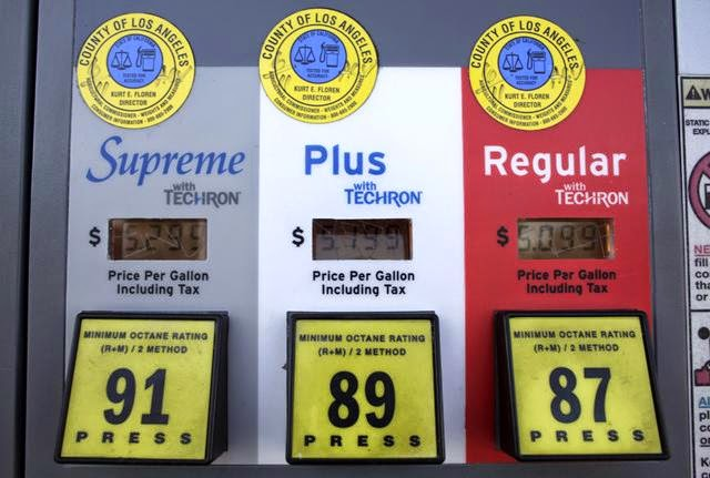 Photo shows gas prices reflected at the pump