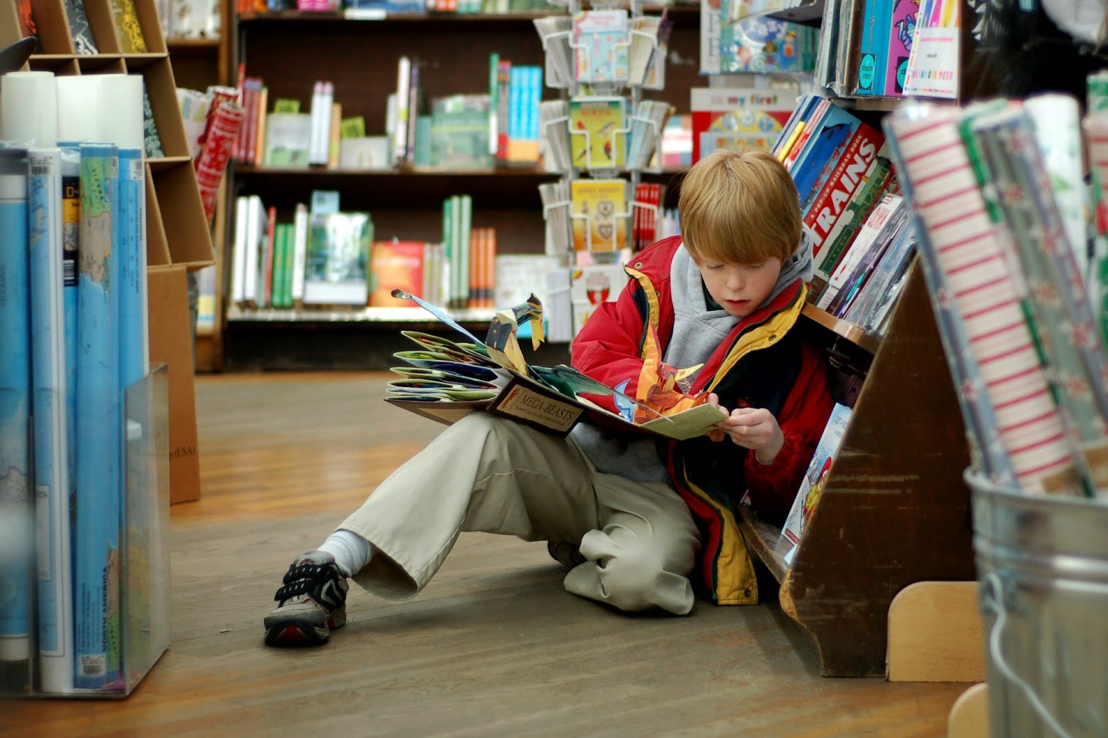 Boy reading in book shop