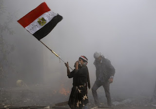 A protester waves an Egyptian national flag