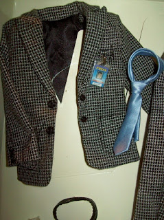 Fashion Insider Ken's black tweed jacket, black belt, and light blue tie