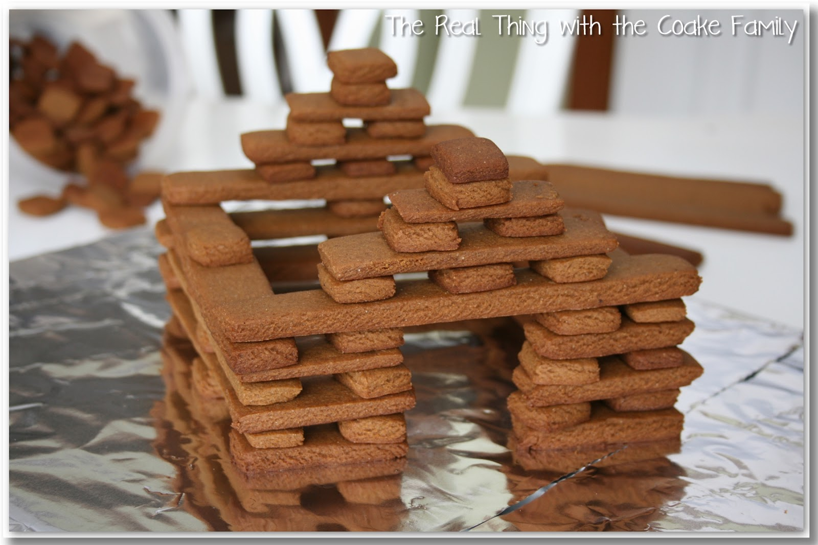 Christmas activities gingerbread house recipe the real thing with place your final 2 log on top of the 2 spacers use 2 spacers stacked on top of each other for the final pieces to support your roof maxwellsz