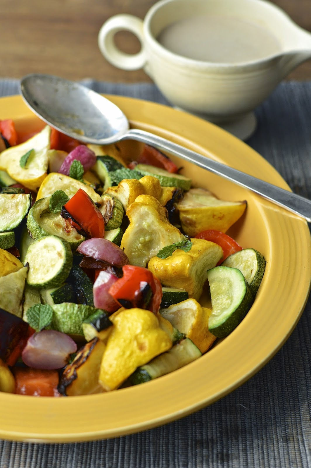 Summer veggies roasted on the grill and drizzled with a smokey lemon tahini dressing