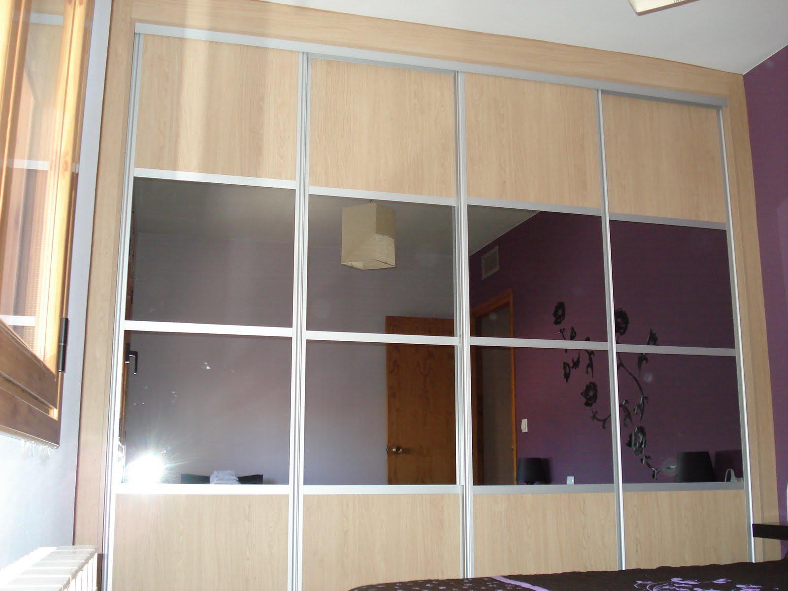 para este dormitorio hemos diseado un armario empotrado de puertas correderas con perfiles de aluminio y un frontal terminado en una combinacin de roble