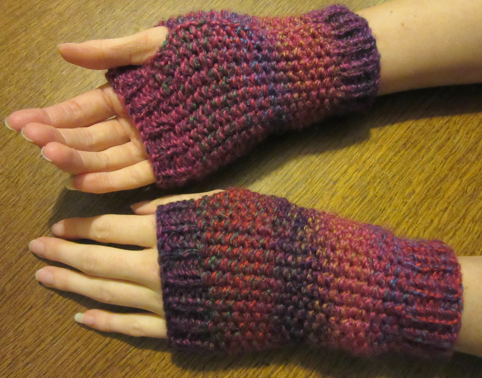 Hands and wrists modelling knitted wrist warmers
