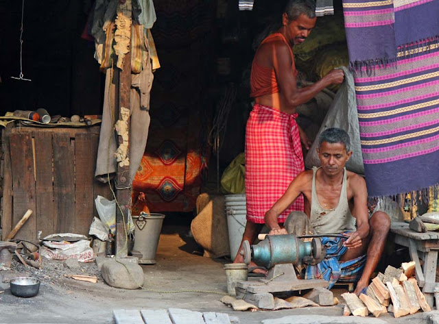 knife sharpener working in his hut
