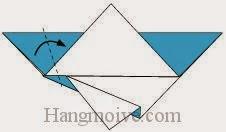 Bước 5: Gấp chéo góc bên trái tờ giấy về phía bên phải.