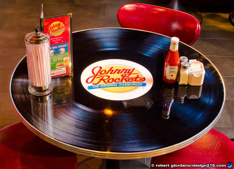 Photo of a table shaped like a phonograph record at Johnny Rockets, Copyright 2012 Robert Giordano