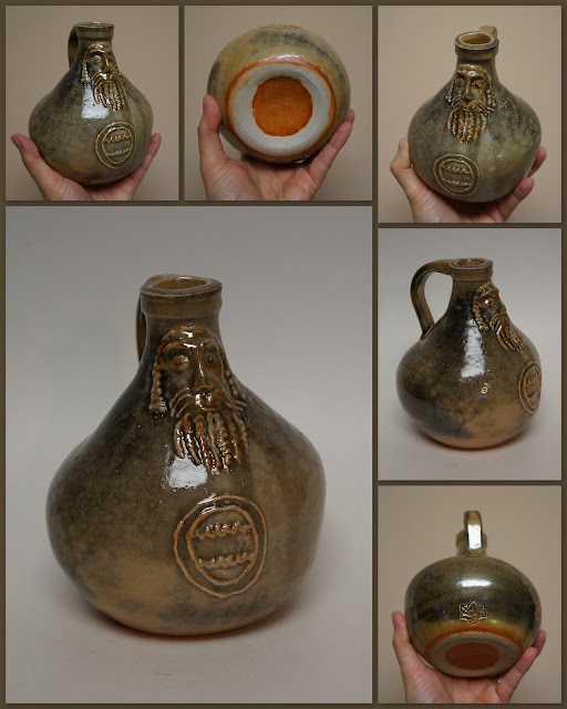 Beautiful pottery Bartmann or Bellarmine jug (replica) by Lily L.
