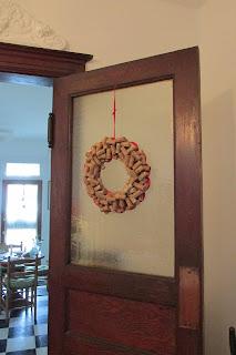 interior door with wreath hanging on top of frosted glass portion of door