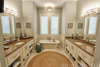 double bathroom design centered in round rugs