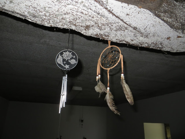 Fotografia de Espanta Espíritos e Dreamcatcher pendurados no tecto