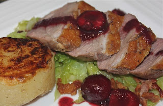 Delicious duck with cherry sauce, fondant potato and savoy cabbage