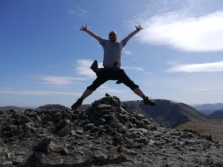 A celebratory leap into the air upon reaching the top of St Sunday Crag