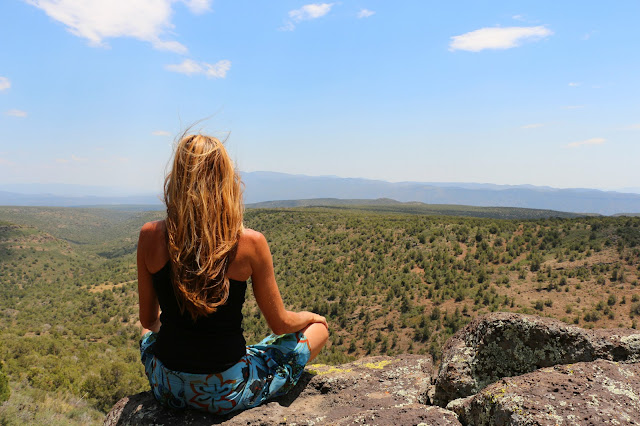 girl meditating on mountain
