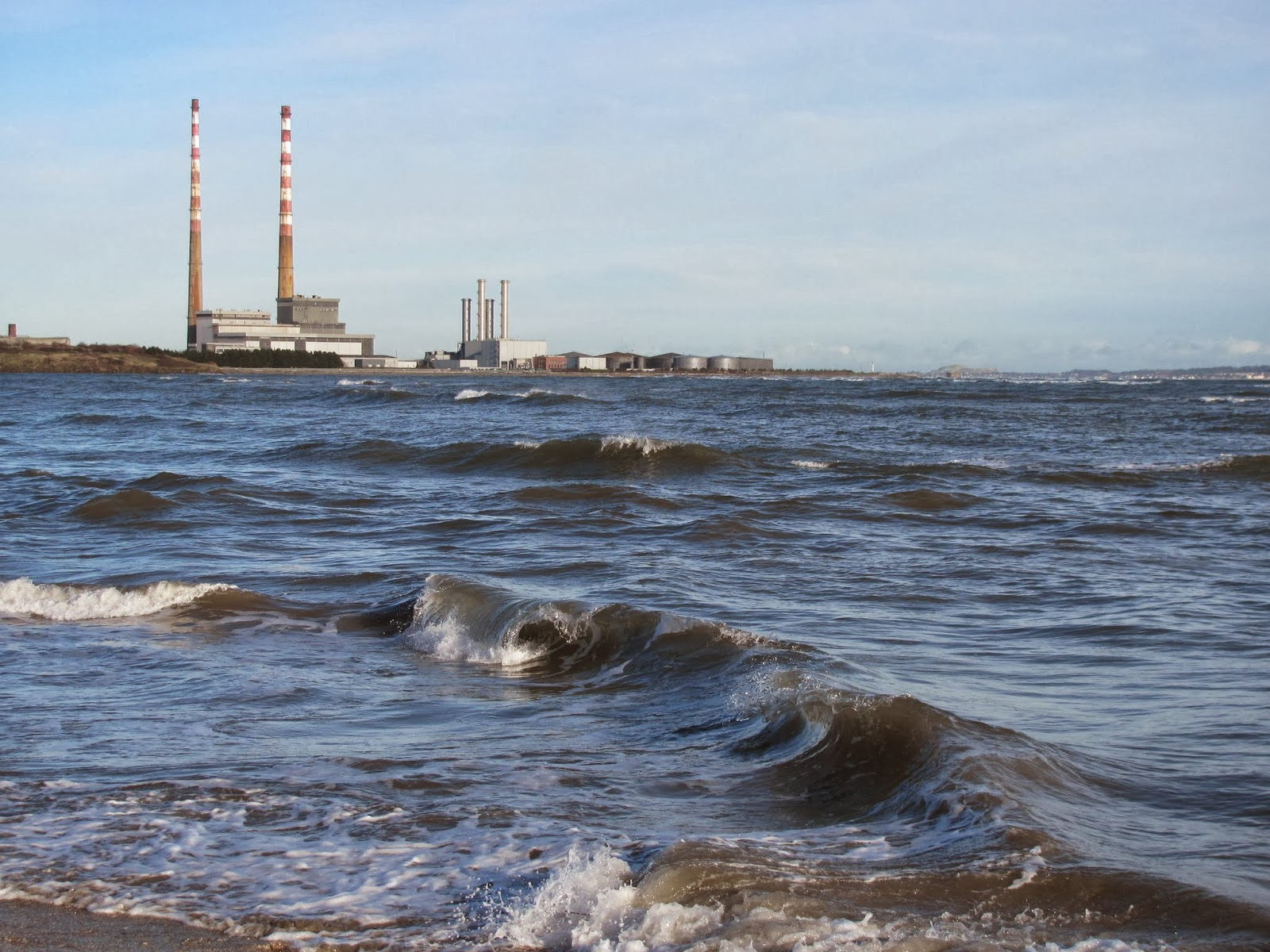 Dublin smokestacks photographed from Sandymount Strand