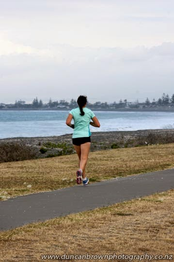 Running along the Rotary Pathway at Westshore photograph