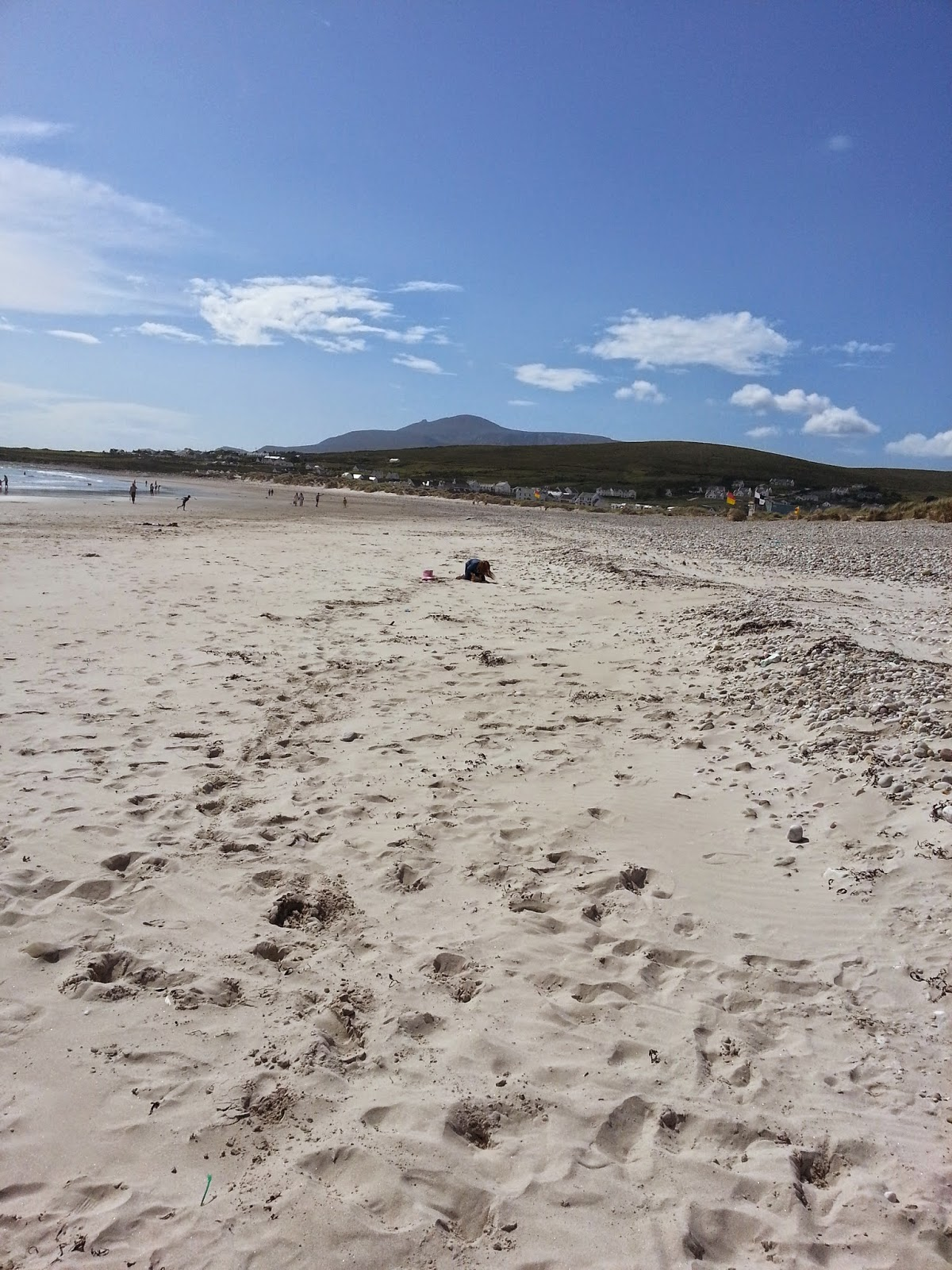 long shot of keel beach achill island with croghan mountain in the backgound