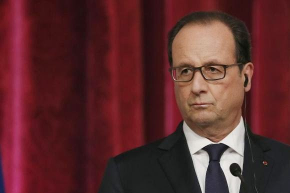 France's President Francois Hollande attends a joint news conference with Palestinian President Mahmoud Abbas (not pictured) at the Elysee Palace in Paris September 19, 2014. (Credit: Reuters/Gonzalo Fuentes) Click to enlarge.