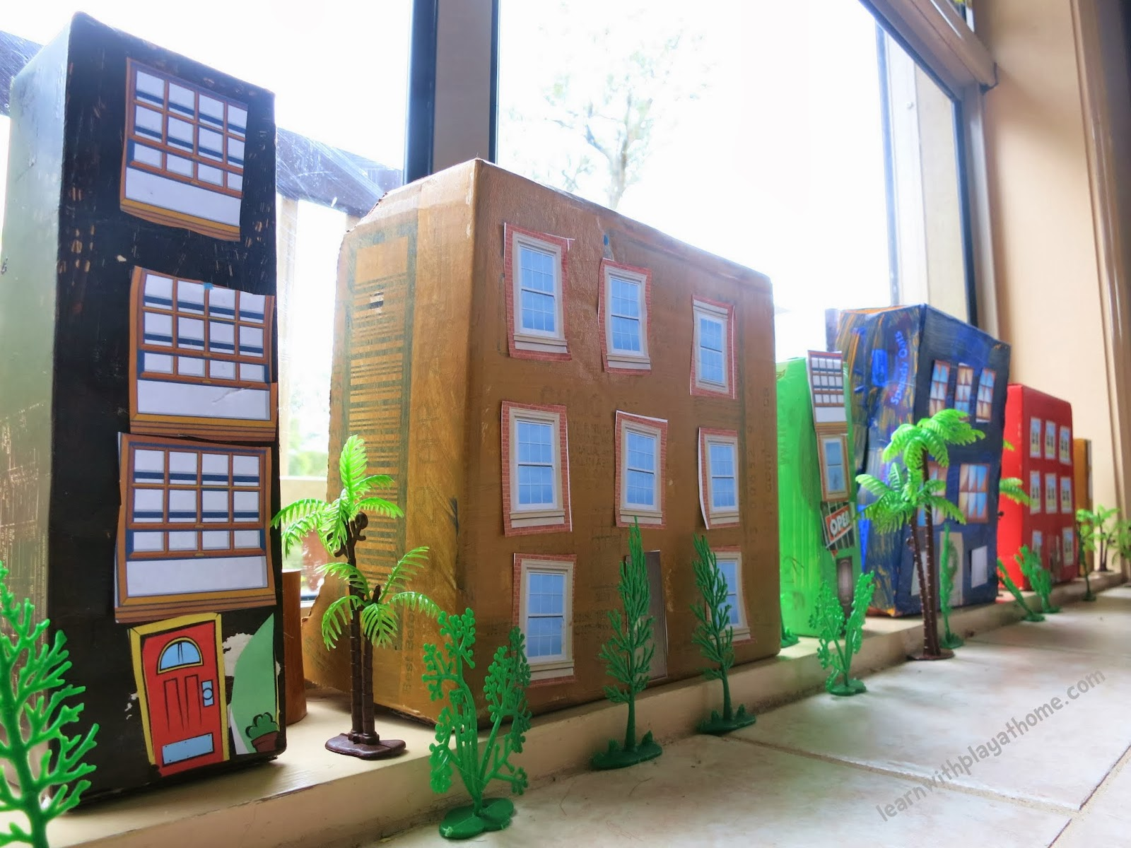 Make your own easy box city with these free printable windows and doors