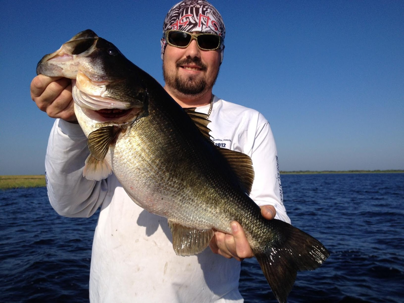 Trophy bass caught on first fishing trip lake okeechobee for Lake okeechobee bass fishing