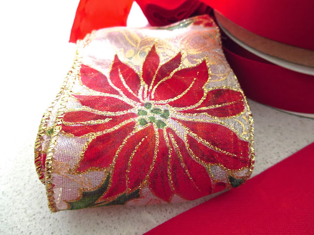 Holiday ribbon with a poinsettia and gold glitter