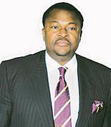 Dr. Mike Adenuga