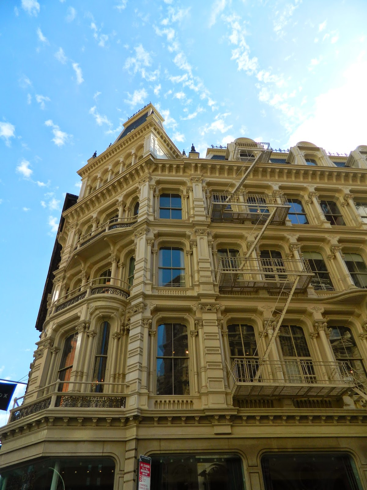 new york city architecture gold brown fire escape big windows summer