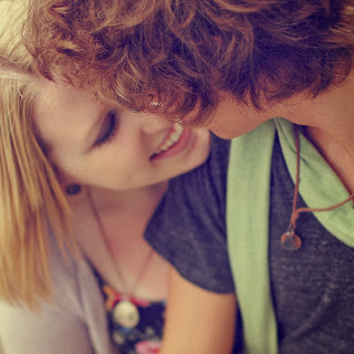 boy and girl in love smiling kissing