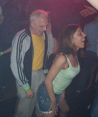 Funny picture: grandpa dancing with young chick in the nightclub