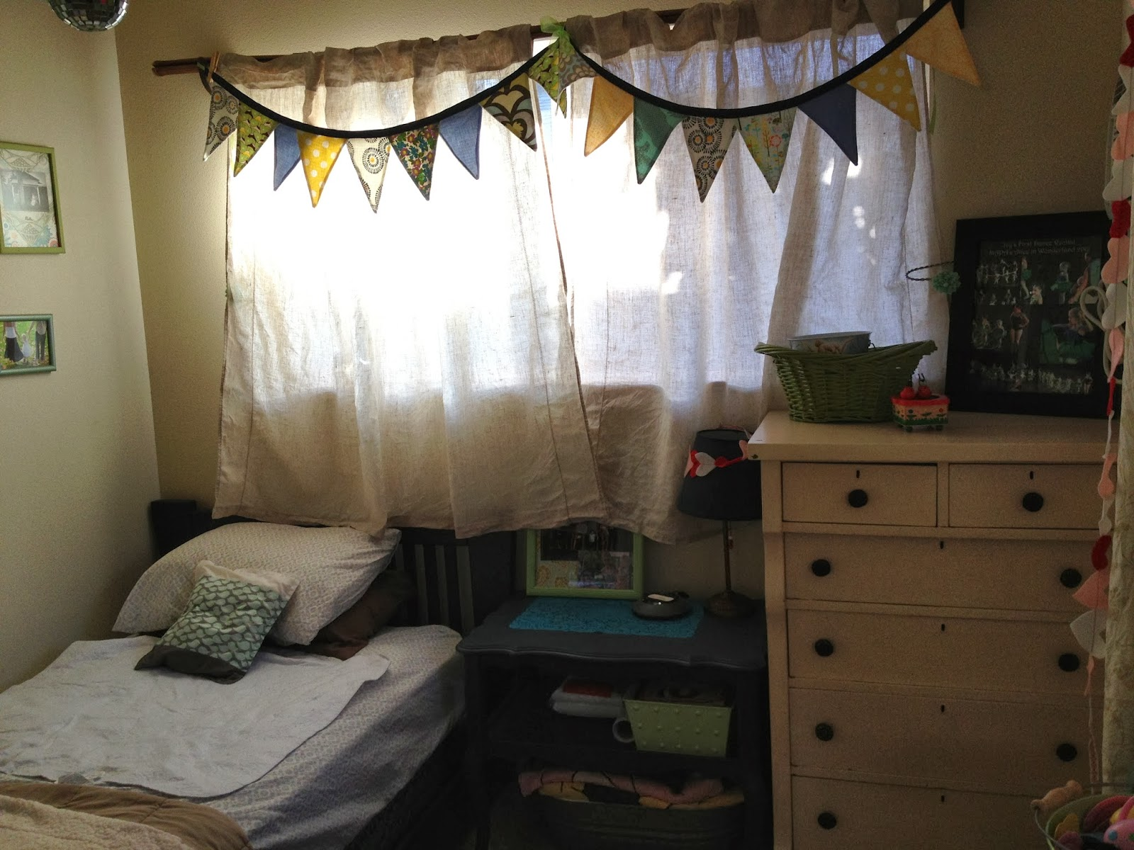 blue kids room with blue green bunting