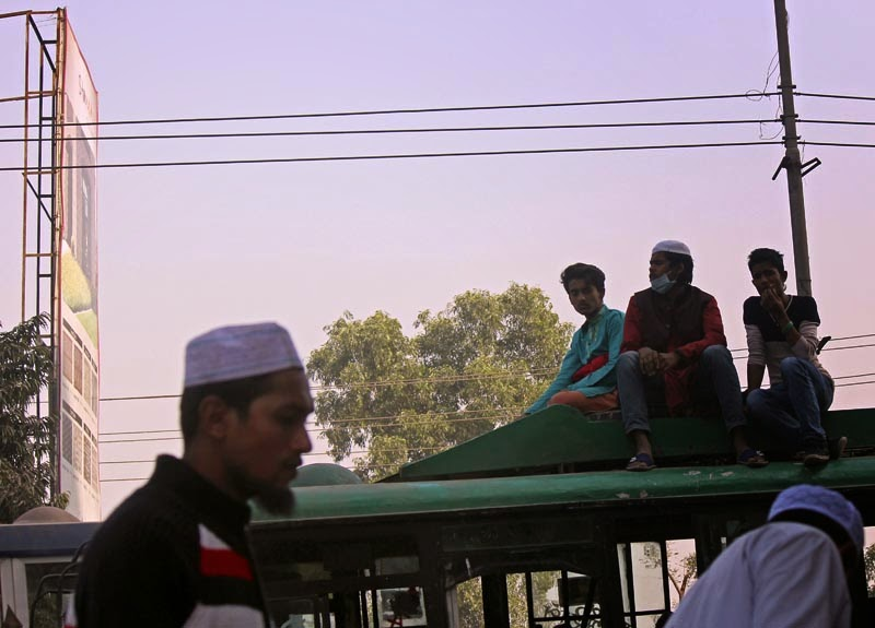 Bus passengers on roof