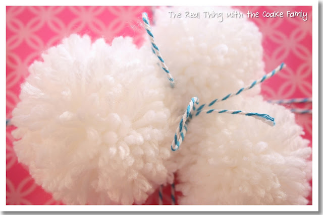 Gift wrap idea using adorable pom poms. #GiftWrap #Gifts #PomPoms #RealCoake