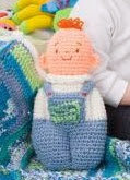http://www.redheart.com/free-patterns/baby-doll-toy-blanket