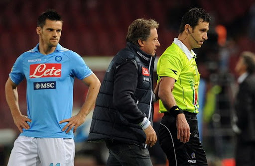 Referee Daniele Doveri is led from the pitch with an injury