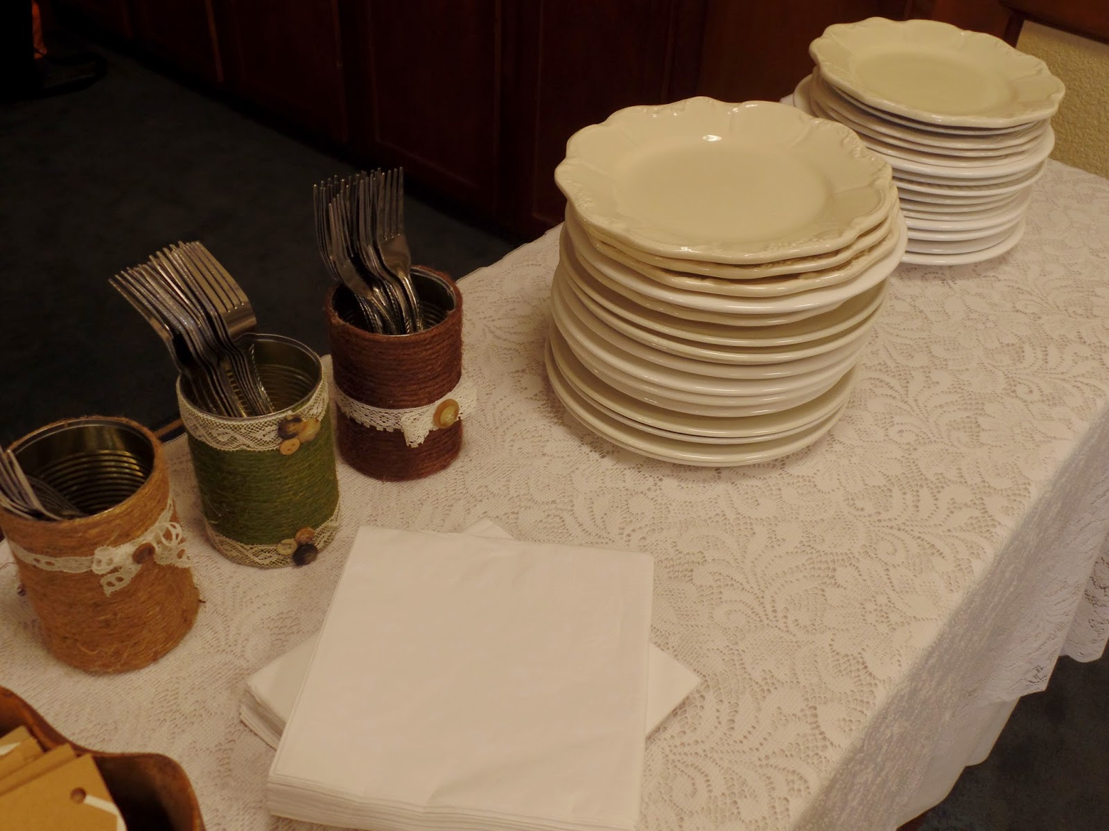 mixed matched plates and twine and lace cans for rustic wedding