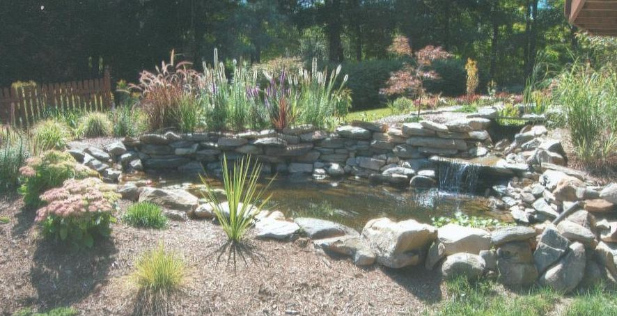 The complete handyman natural stone pond landscape for Pond stones landscaping