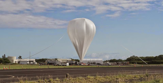 Crews from the Columbia Scientific Balloon Facility prepare the balloon for flight for the 2014 NASA Low-Density Supersonic Decelerator test from the U.S. Navy Pacific Missile Range Facility on Kauai, Hawaii. Credits: NASA