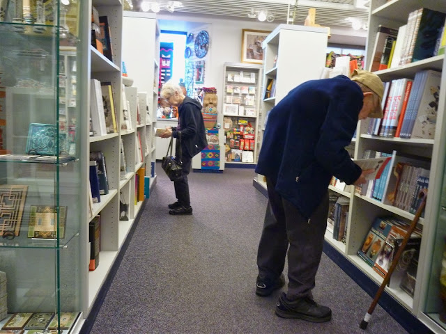 elderly couple shopping bookstore