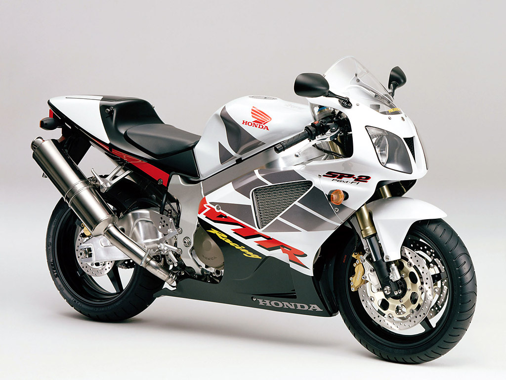 http://3.bp.blogspot.com/-kwwV6_wh_t4/Tckc96799eI/AAAAAAAAAUs/VcNUkwxCZFA/s1600/Honda_VTR_1000_SP-2_Racing_Bike.jpg