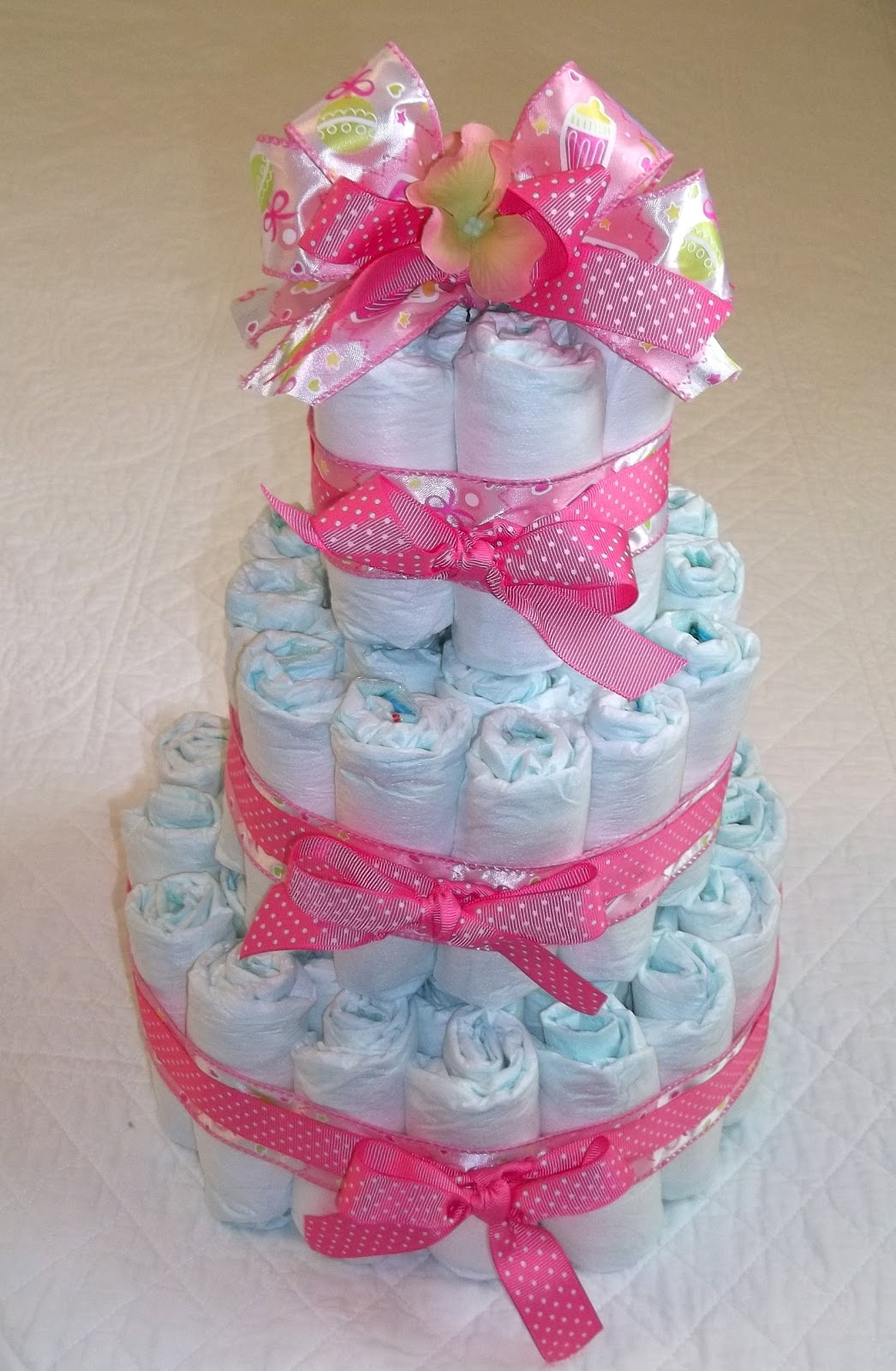 diaper cake for a friend who is throwing a baby shower diaper cakes