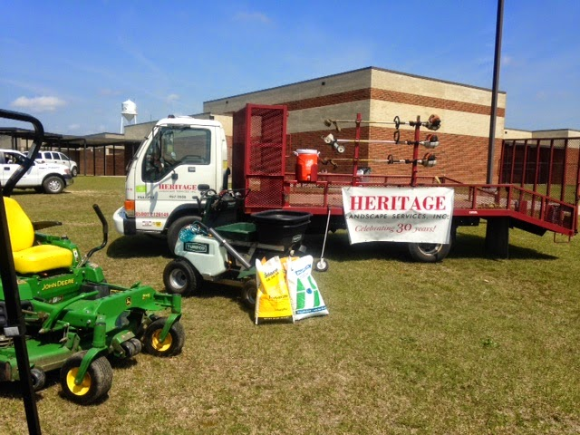 Along with the HLS truck, we had a propane-powered lawn mower, a ride-on  fertilizer spreader and a sod roller. - Heritage Landscape Services