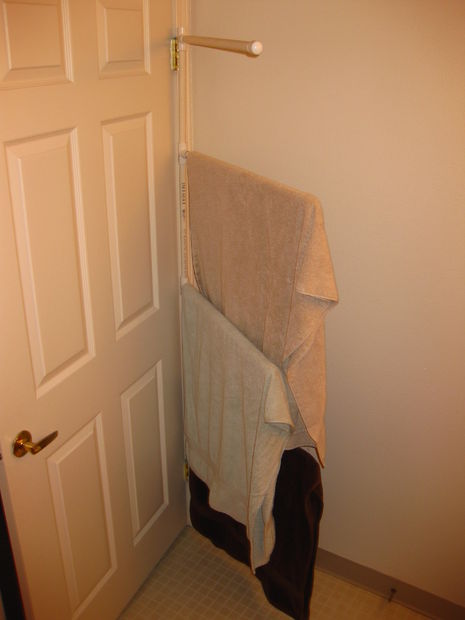 Towel organizer behind the door :: OrganizingMadeFun.com