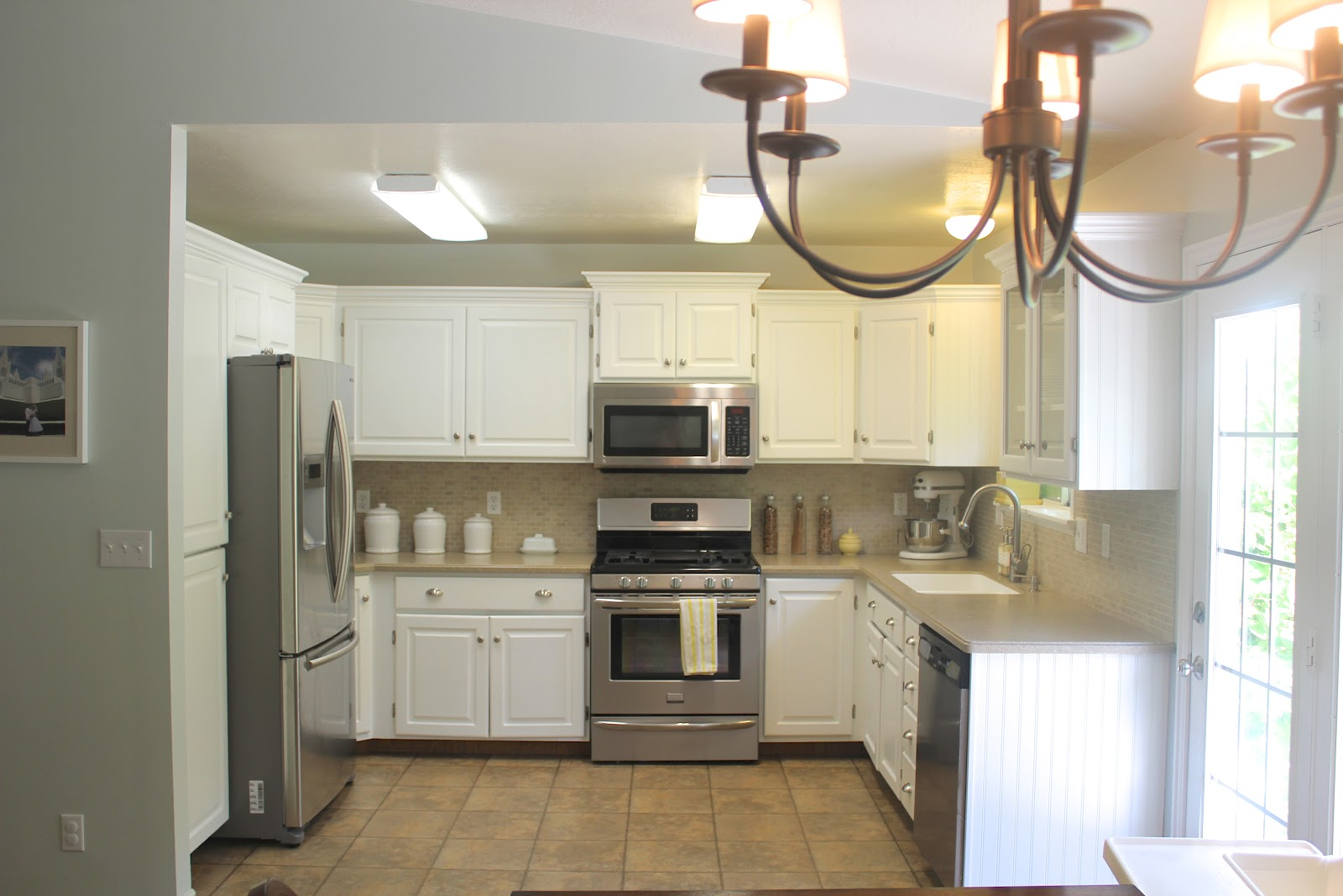 Everywhere beautiful kitchen remodel big results on a for Small upper kitchen cabinets