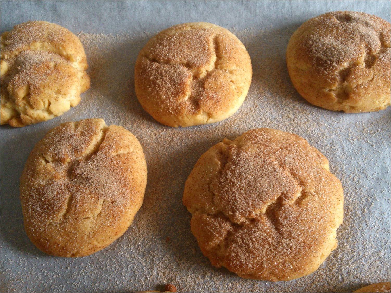 of sugar and 2 teaspoons of cinnamon together than roll each biscuit ...